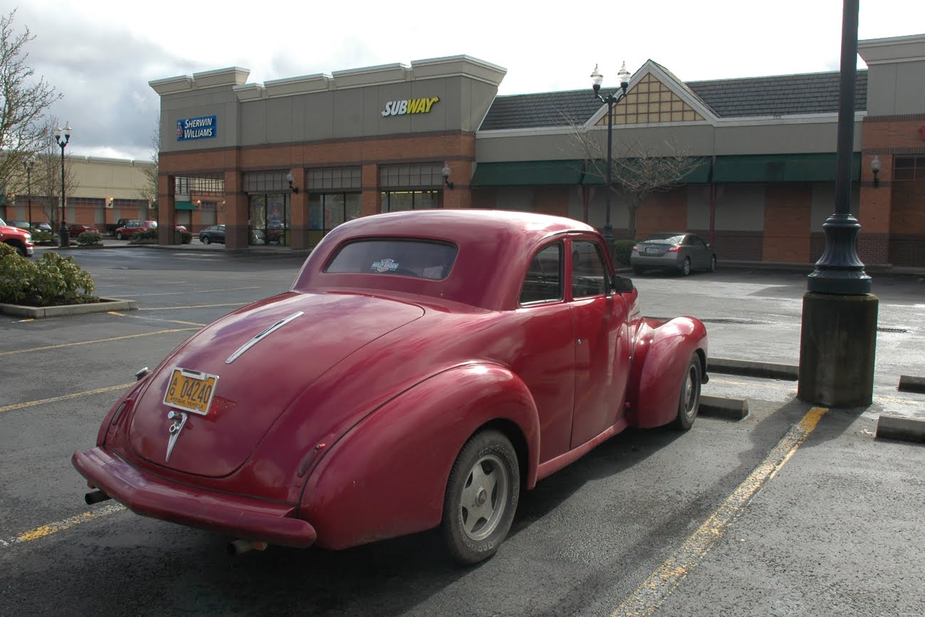 OLD PARKED CARS.: 1941 Studebaker Champion Coupe.
