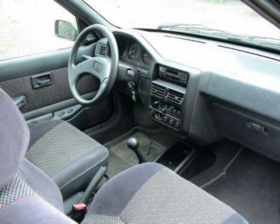 Topworldauto photos of peugeot 106 xt photo galleries for Interieur 106 sport