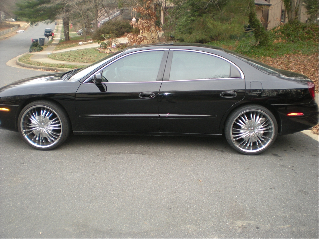 Blk 2003 Olds Aurora, just put some new shoes on it, Blk fresh Leather,