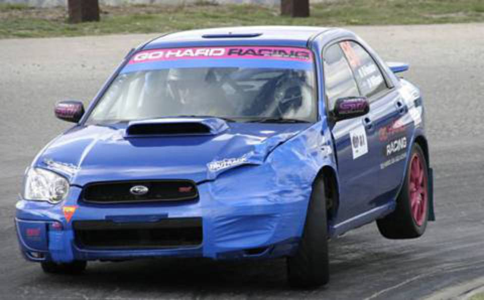 A 2006 Subaru Impreza WRX Spec C off course! The Subaru duo posted their