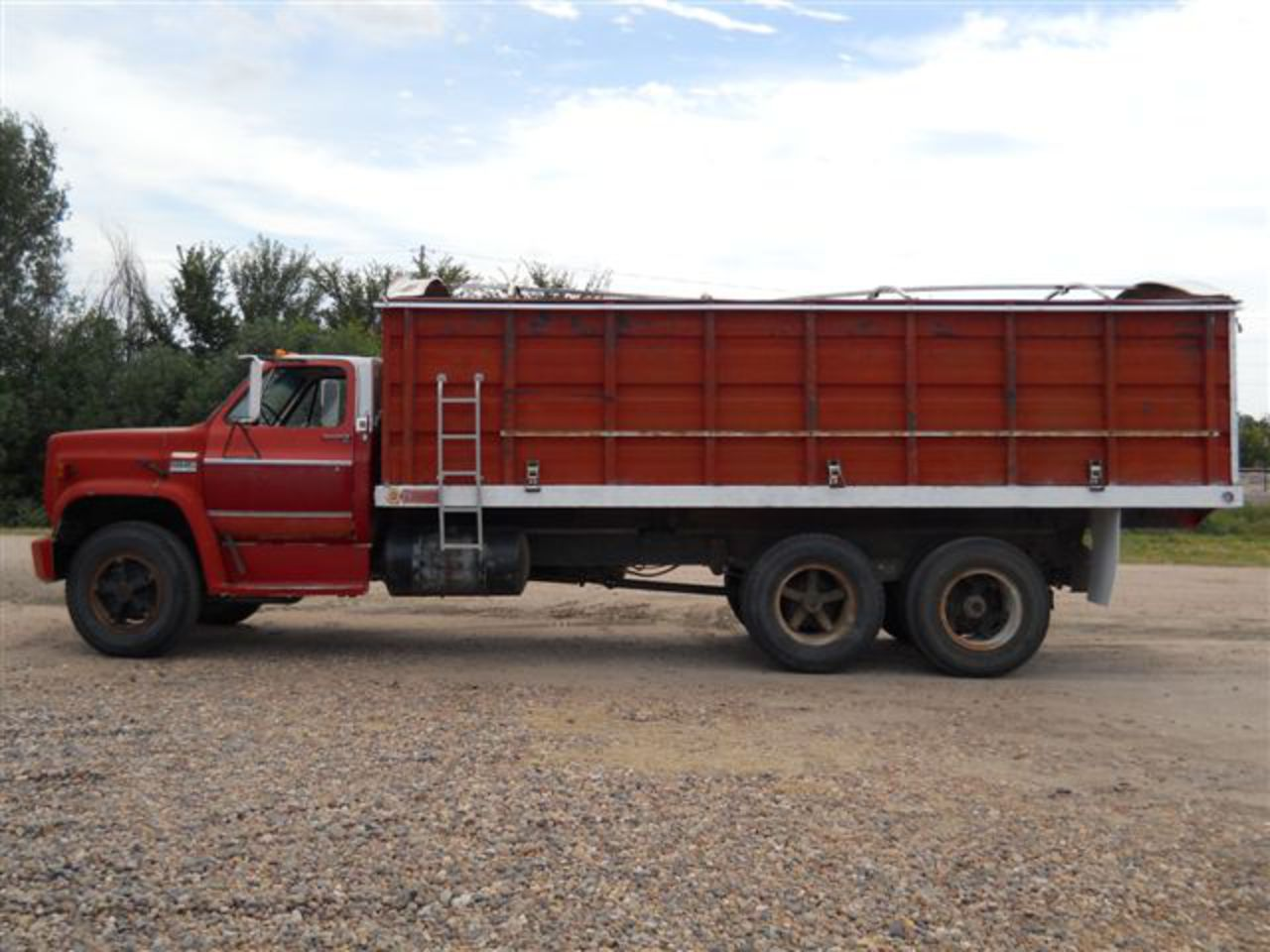 1976 GMC 6500 with good 20 ft. steel box and floor, near new tarp,