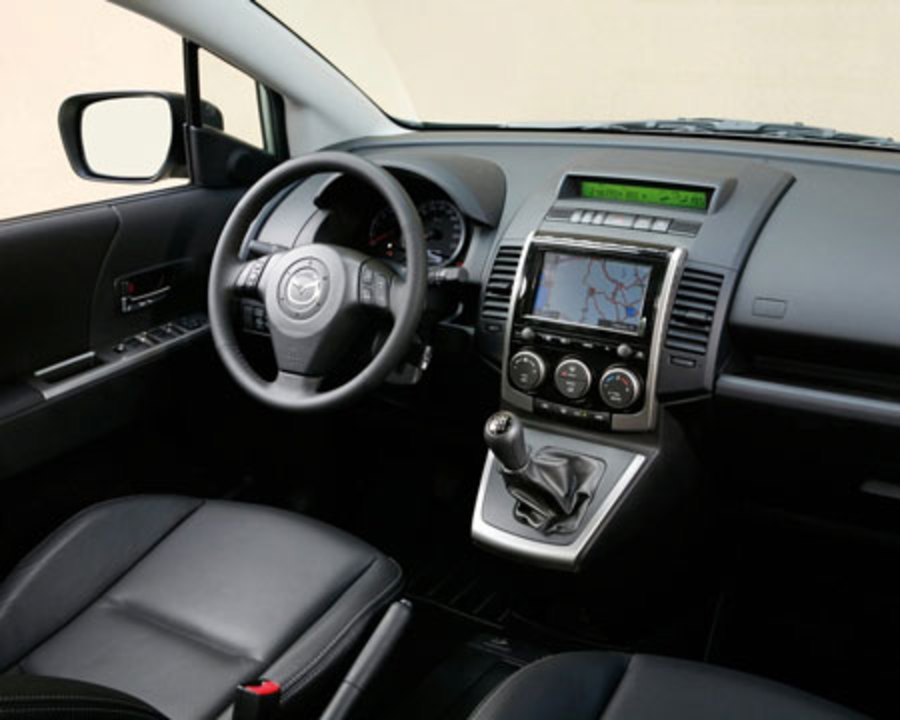 Mazda 5. On the interior, the center dash area has been redesigned to