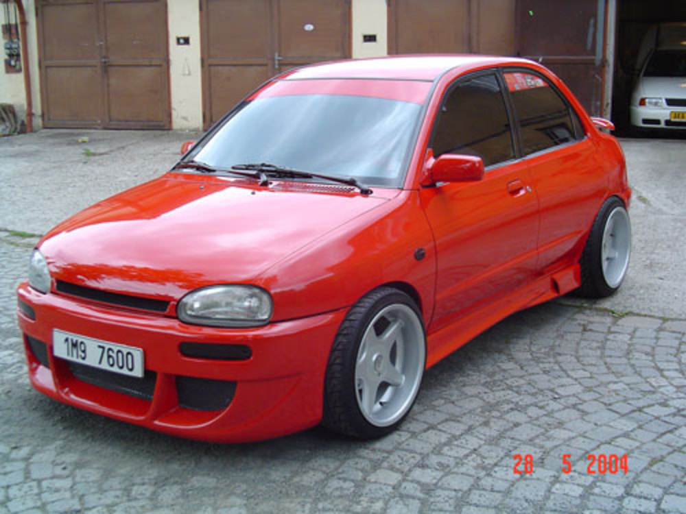 Mazda 121 - huge collection of cars, auto news and reviews, car vitals,