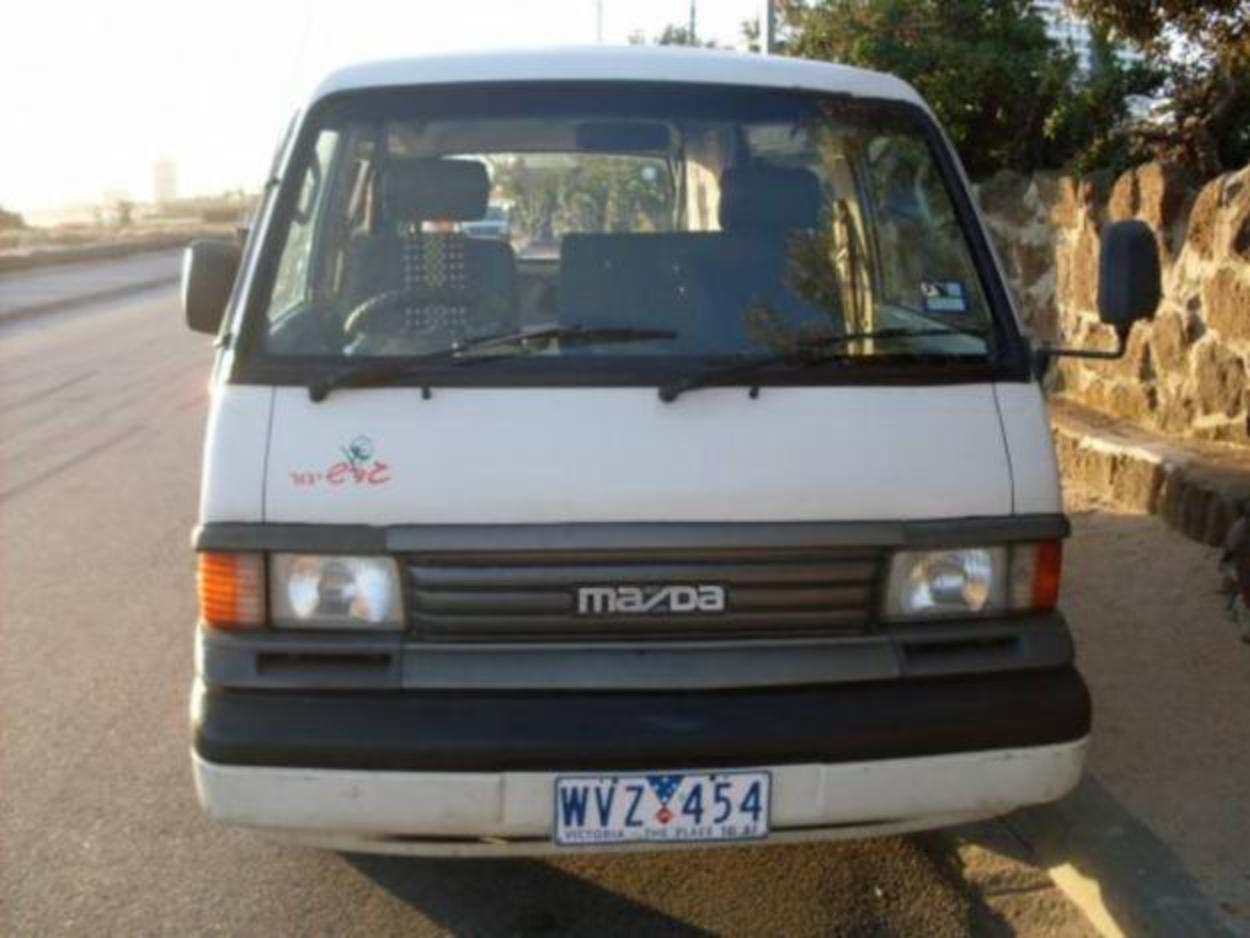 mazda E2000 gas&petrol must fly home - Cairns