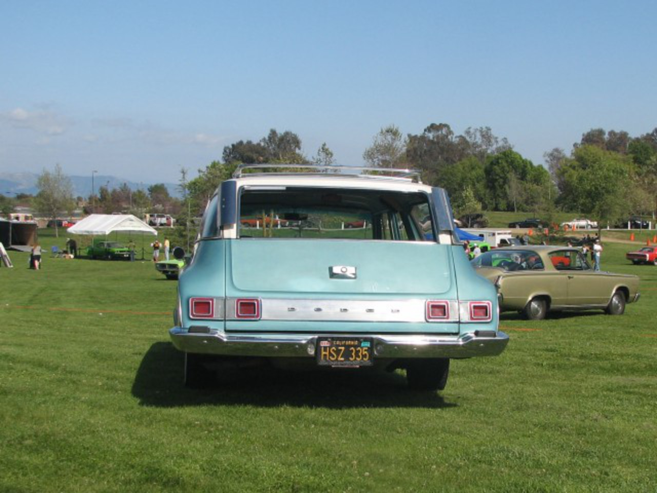 Skywatcher68 is right, and first on the site. 1964 Dodge 440 Station Wagon.
