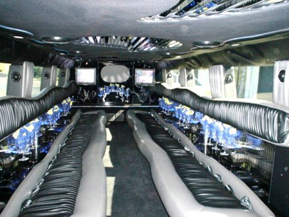 Hummer H2 limo interior. Call 321-636-3330