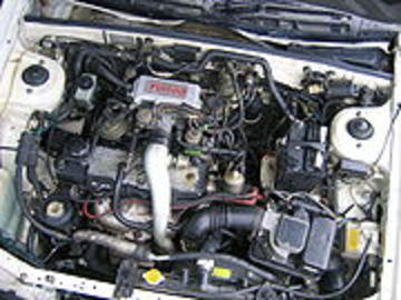 In certain markets a twin-carburetted, high-compression version exists,
