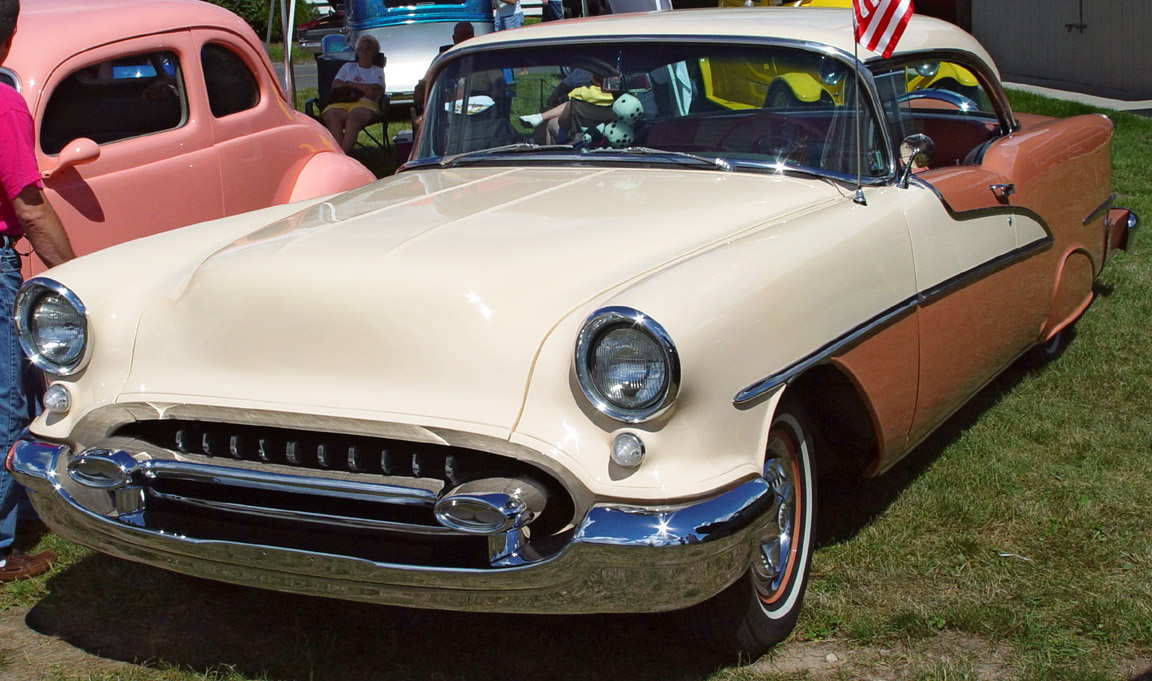 1955 Oldsmobile 98 Holiday Hardtop - Brown & Cream - Front Angle