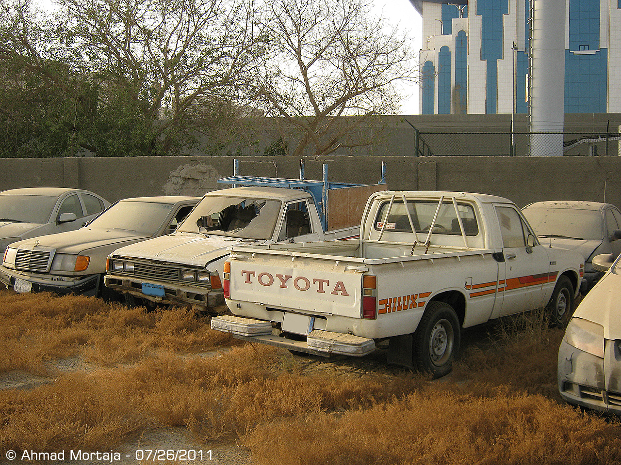 Mercedes-Benz E-Class (W124), Datsun Pick up, and Toyota Hilux ...