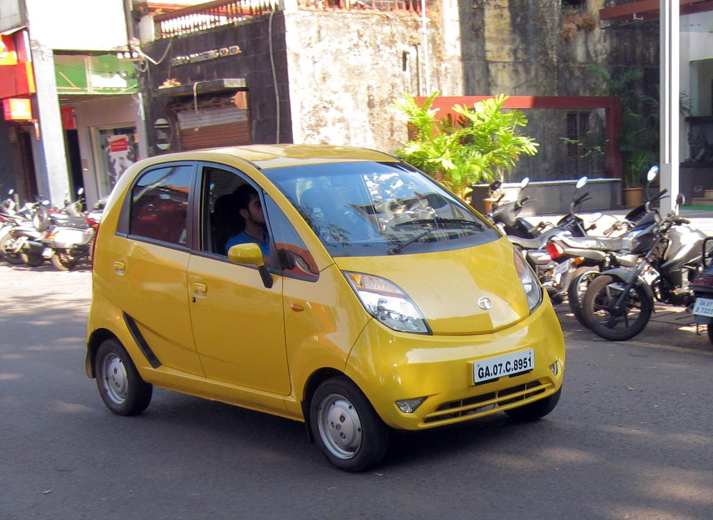 Tata Nano zips past motorcycles it is intended to replace | Flickr ...