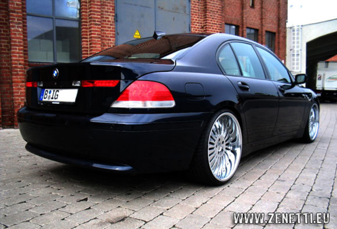 Side view of black color sedan BMW 750i cars overview