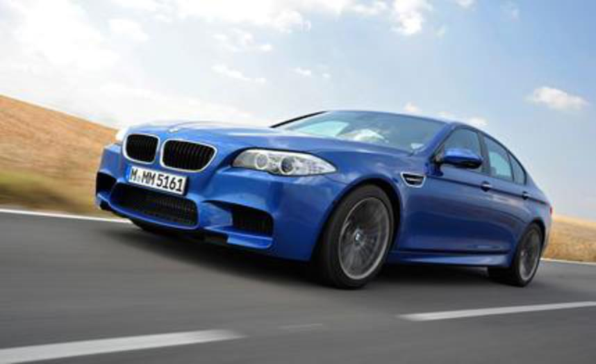 2013 BMW M5. With its new top sedan, the M division continues to tip its own