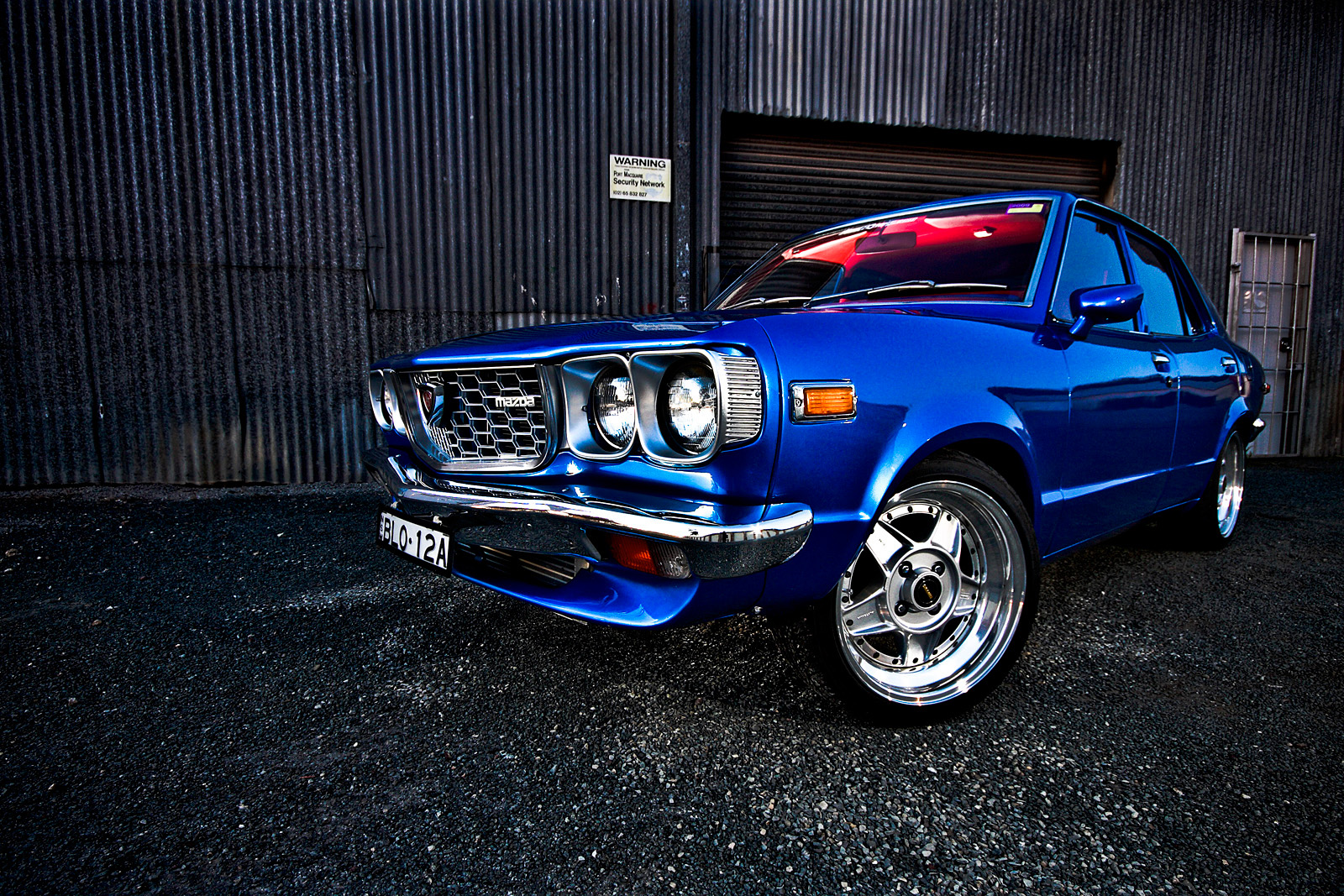 [Image: Mazda_RX3_by_bleed_the_sky.jpg]