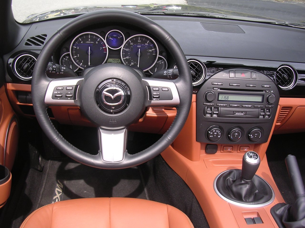 2007 Mazda MX-5 Miata dash detail. 2007 Mazda MX-5 Miata dashboard