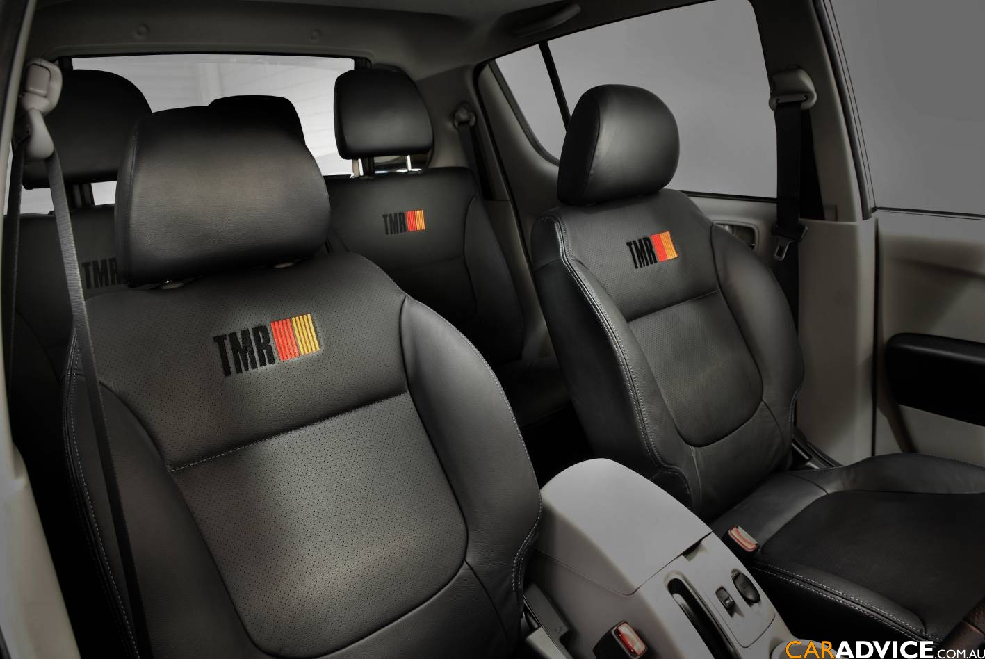 tmrtriton4.jpg. Inside, the car gets leather seats, TMR stitching and logos,