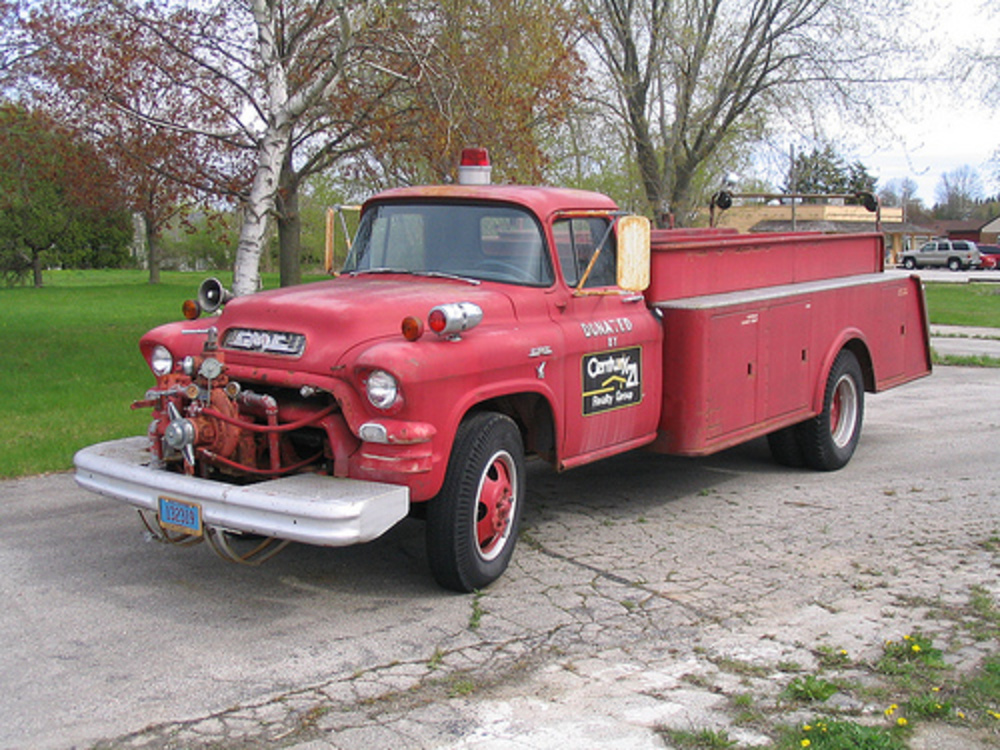1955 GMC fire truck. This 1955 GMC medium-duty truck outfitted with a 1956
