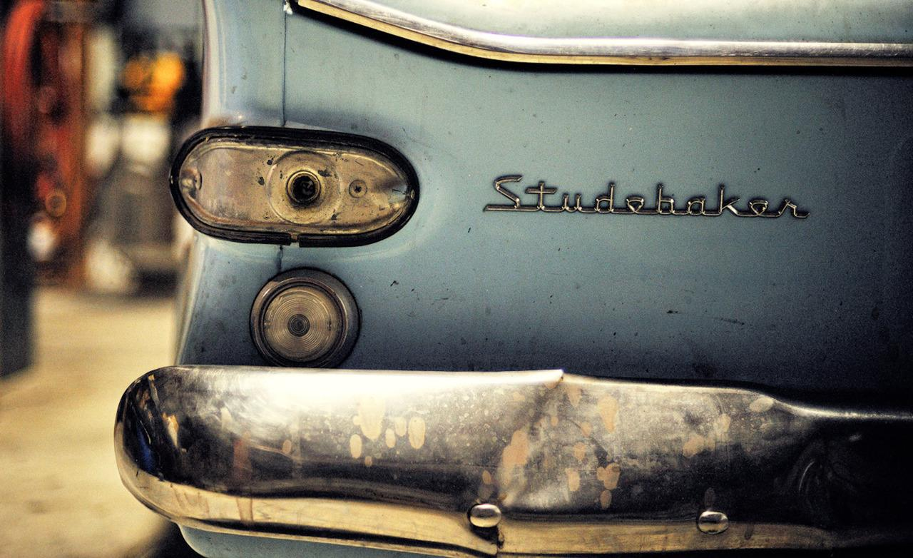 Studebaker Lark VI taillight and rear badge photo