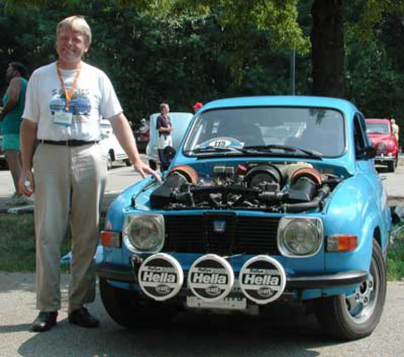 9644.jpg Here, Mikael poses with one of his rally cars, this one sporting