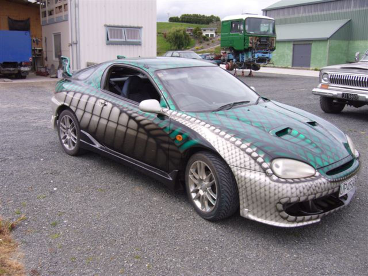 Mazda Coupe finished October 2006, with full custom body kit finished with a