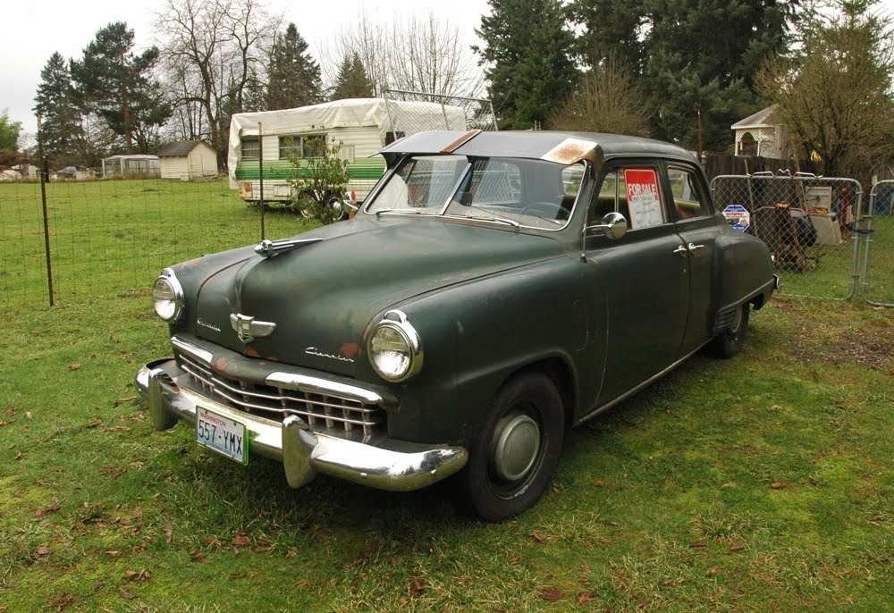 OLD PARKED CARS.: 1949 Studebaker Champion.