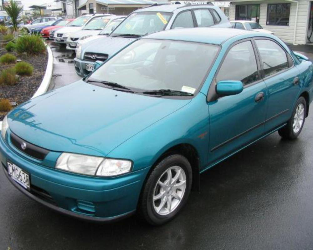 Mazda Familia Interplay X - huge collection of cars, auto news and reviews,