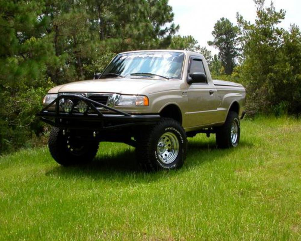 It's a 2WD 2000 Mazda B2500. The front bumper was made by sterling equipment