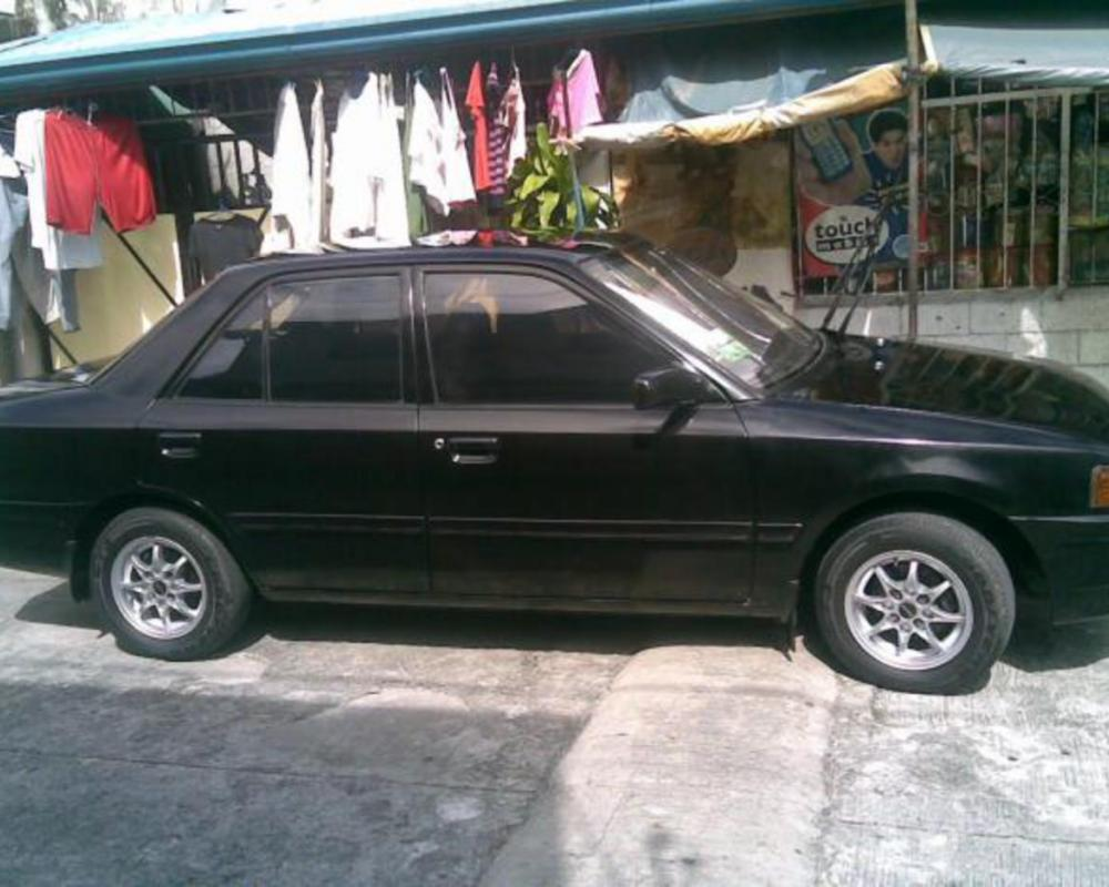 Pictures of MAZDA 323 Sedan 95model 115K negotiable