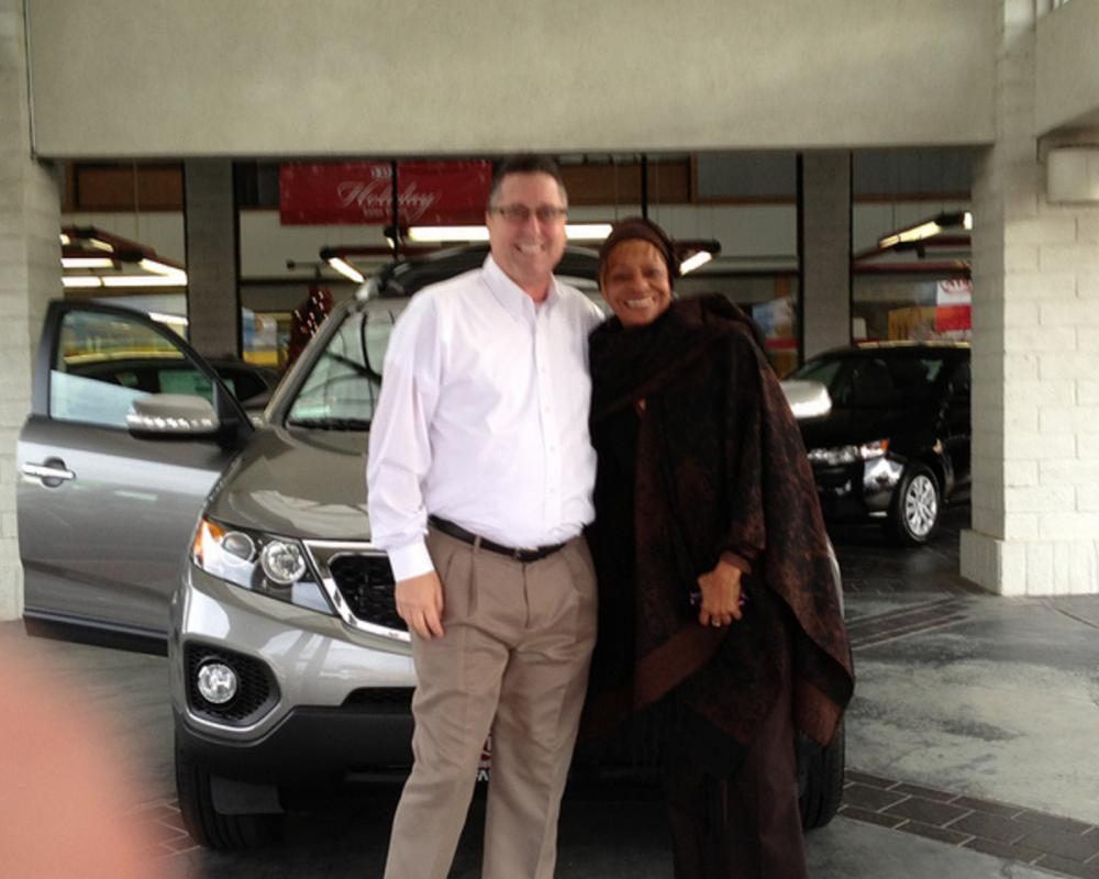 Ms. Townes with her 2013 KIA Sorento EX from JC Cummings at Kia of ...