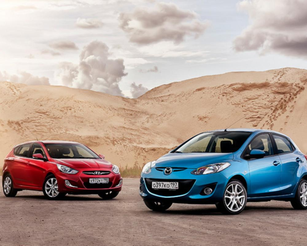 Mazda 2 and Hyundai Solaris | Flickr - Photo Sharing!