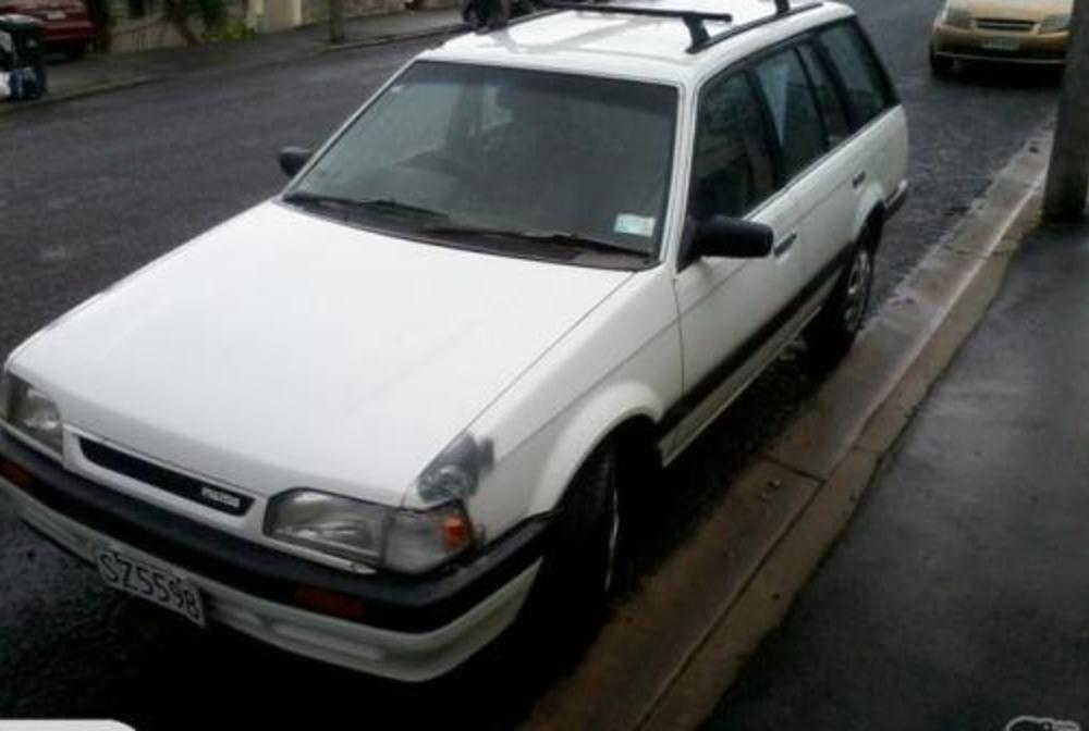 """Mazda 323 GLX Wagon 1994"". Photo may not be of this vehicle but of a"
