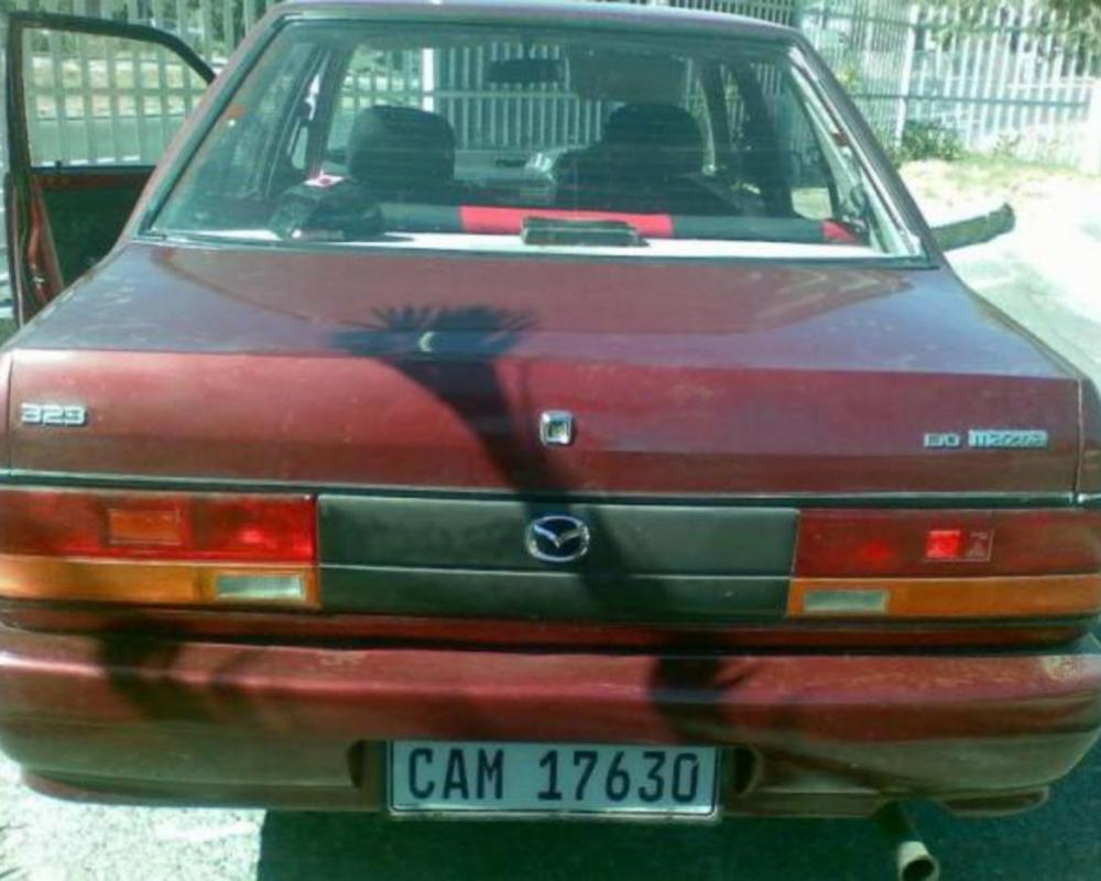 Mazda 323 16 Sedan - huge collection of cars, auto news and reviews,