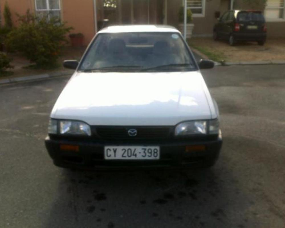 Pictures of 2001 White Mazda 323, 1300 for sale
