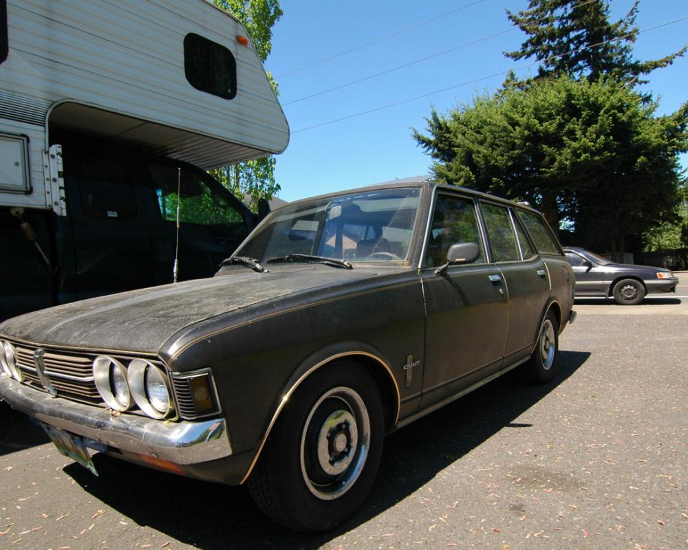 OLD PARKED CARS.: 1972 Dodge Colt Station Wagon.
