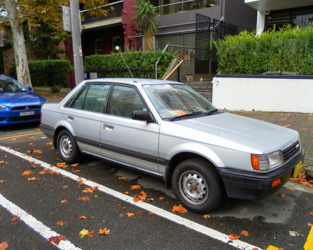 Aussie Old Parked Cars: 1985 Mazda BF 323 1.6 Sedan